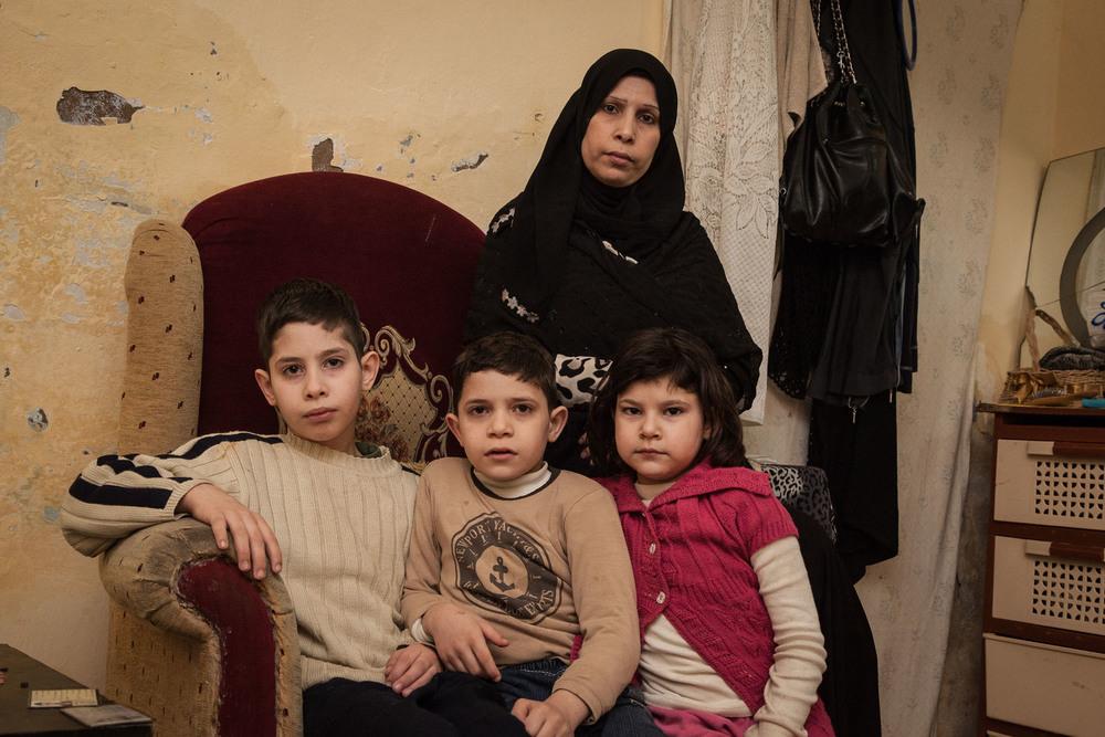 Ahmed al-Qaed a laissé derrière lui sa femmeAmal et leurs trois enfants, Mahmood, Omran et Raghed
