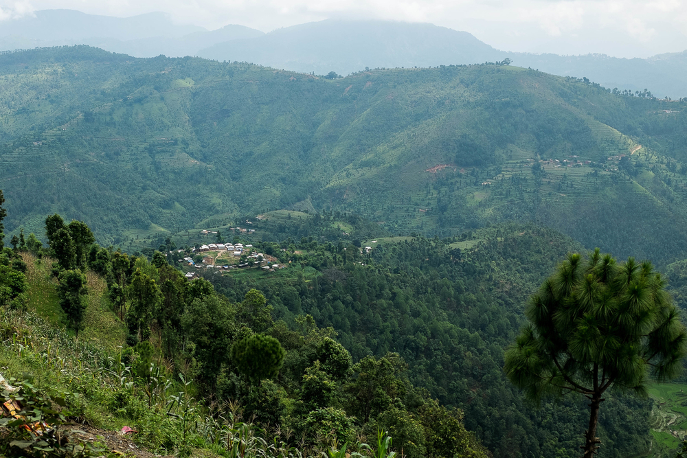 A village destroyed by the earthquake can be seen in the distance on 10 August 2015 in Sindhupalchowk district.