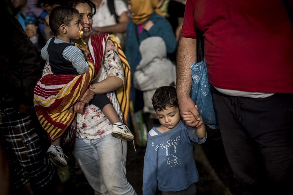 The second group of Syrian refugees are escorted over the border