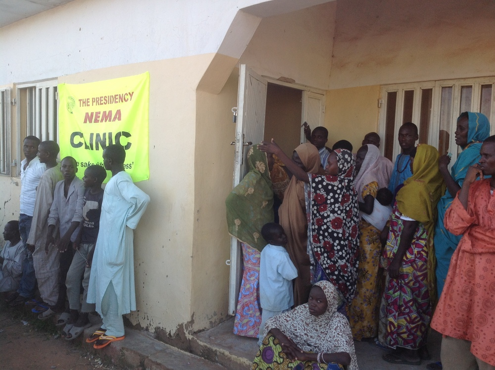IDPS returning from Cameroon at Fufore IDP camp queuing for medical check up at a local clinic (Ibrahim Abdul'Aziz)