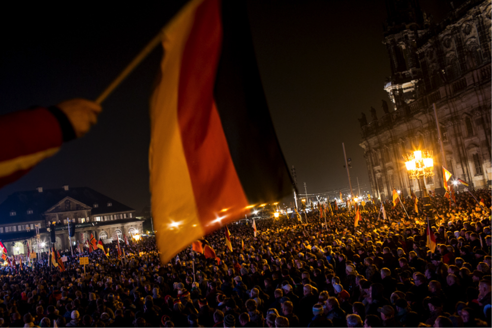 PEGIDA's first anniversary rally in Dresden attracted as many counter-protesters as it did supporters (Andrei Pungovschi/IRIN)