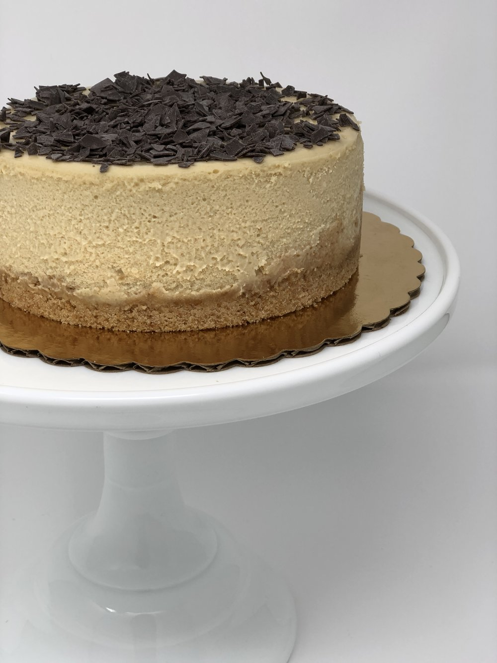 VIETNAMESE COFFEE CHEESECAKE - Coffee lovers, this one is for you! Using a Vietnamese coffee filter, we slow brew a dark french roast which after combined with our cheesecake batter creates a rich in flavor and incredibly creamy cheesecake. We highly suggest drizzling condensed milk right before serving for the full Vietnamese Coffee effect.