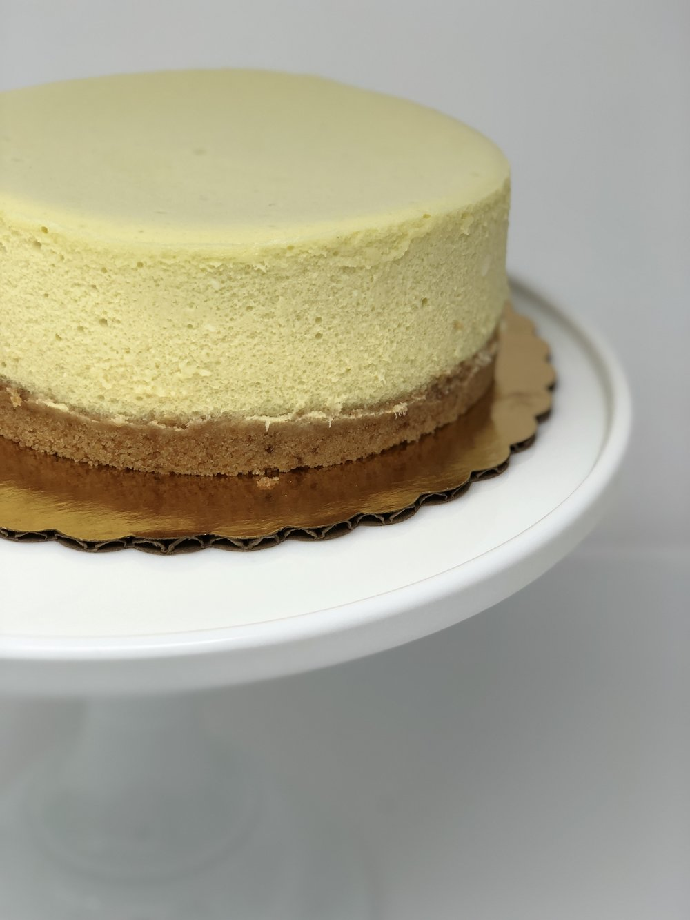 COCONUT PANDAN CHEESECAKE - Deliciously delicate cheesecake with a subtle coconut and pandan flavor. We extract the sweet and incredible flavor of pandan by grinding fresh pandan leaves with coconut milk. Pandan is a type of plant that grows in tropical areas of Asia and is commonly used in Southeast-Asian countries.