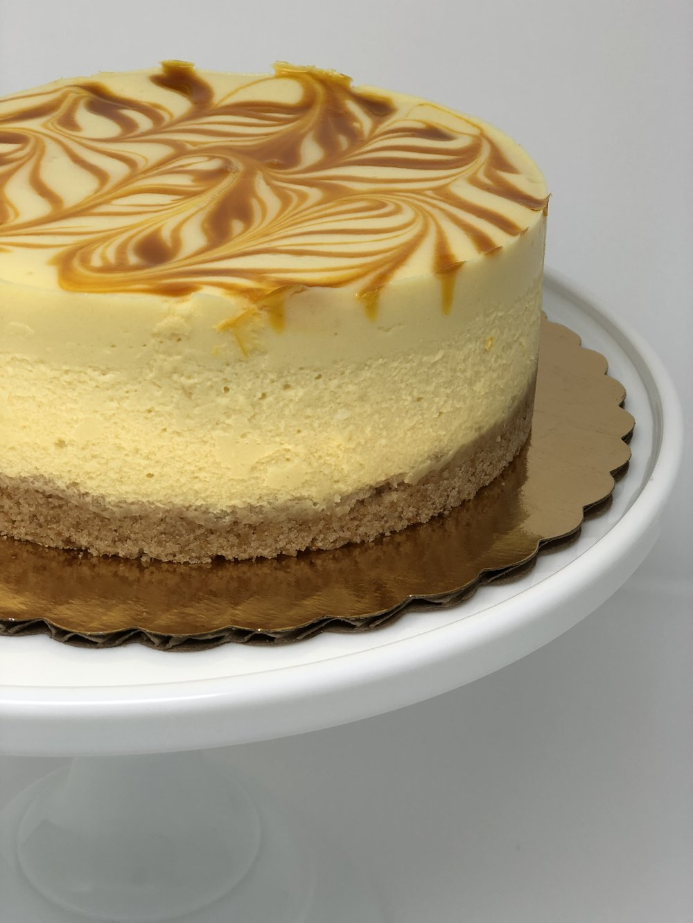 CALAMANSI MANGO CHEESECAKE - Tart and creamy, this cheesecake is inspired by the classic lemony cheesecake and swirled with an all natural mango puree. Instead of fresh lemons, calamansi takes front stage. The Calamansi, also known as the Calamondin orange, is mainly cultivated in the Philippines, and is a small fruit which looks similar to a lime and descends from the mandarin orange.