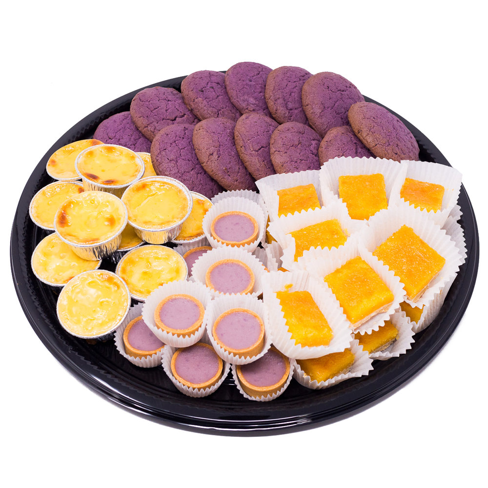 "Sari Sari Filipino Dessert Platter $39 half / $75 full   Sari Sari means variety in Filipino. This platter includes 24 (half size) or 48 (full size) total pieces of the following variety of desserts- 2-bite calamansi ""lemon bars"", cassava cake, ube mini tarts, and ube cookies."