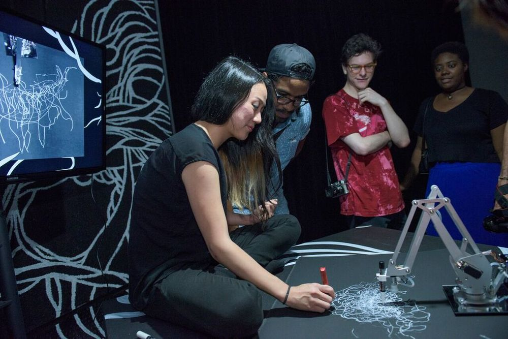 Artist Sougwen Chung demonstrates drawing robot  D.O.U.G. , made in collaboration with Yotam Mann for the 2015 NEW INC End of Year Showcase at Red Bull Studios NYC