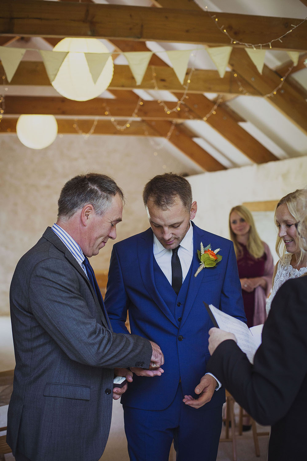 groom receiving rings from ring bearer at nantwen