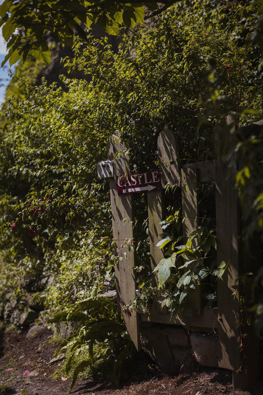 usk castle sign on gate