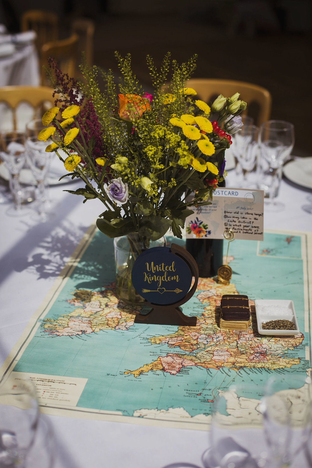 wedding flowers with table name on map of the united kingdom at wedding breakfast