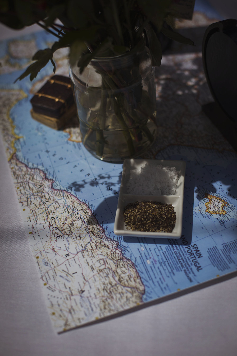 salt and pepper dish on map at wedding breakfast at usk castle