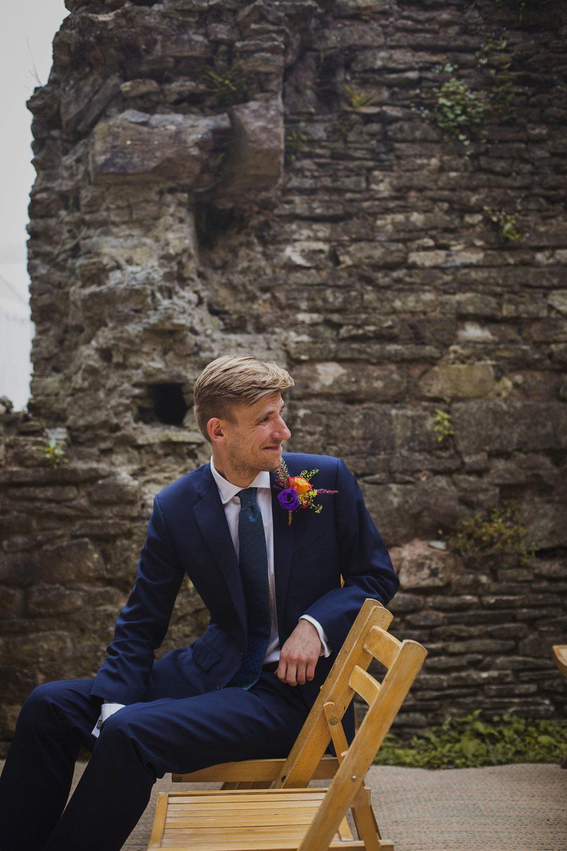 groom smiling as bride arrives at wedding ceremony at usk castle