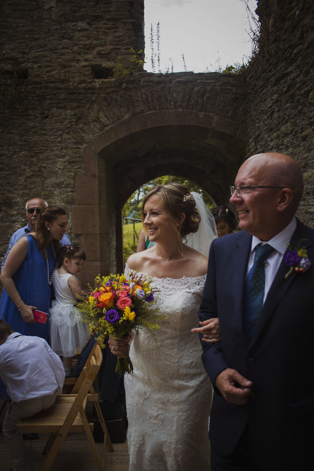 bride arriving at wedding ceremony with her father at usk castle