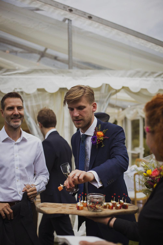 groom taking a horderve at usk castle