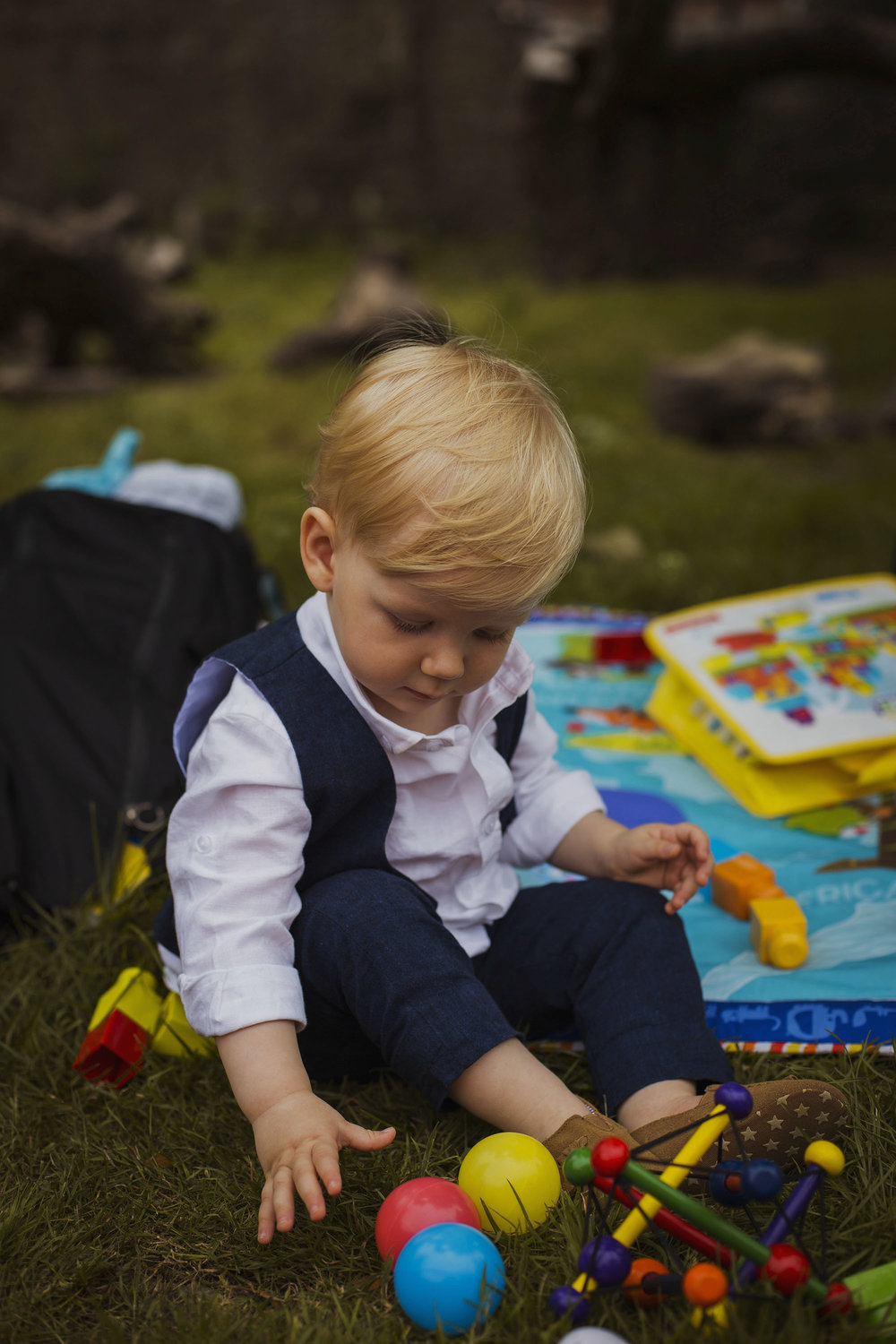 bride and groom's son playing with toys at wedding at usk castle