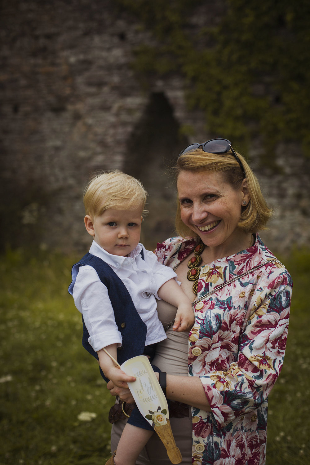 groom's mother holding bride and groom's baby boy at wedding at usk castle