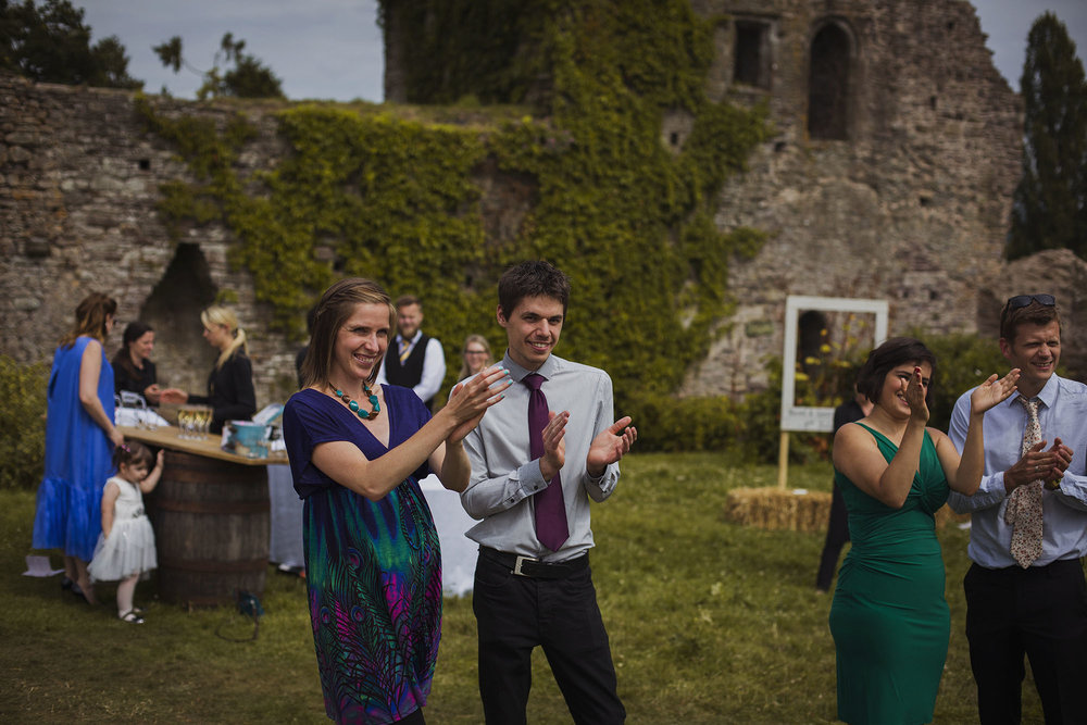 wedding guests clapping at usk castle