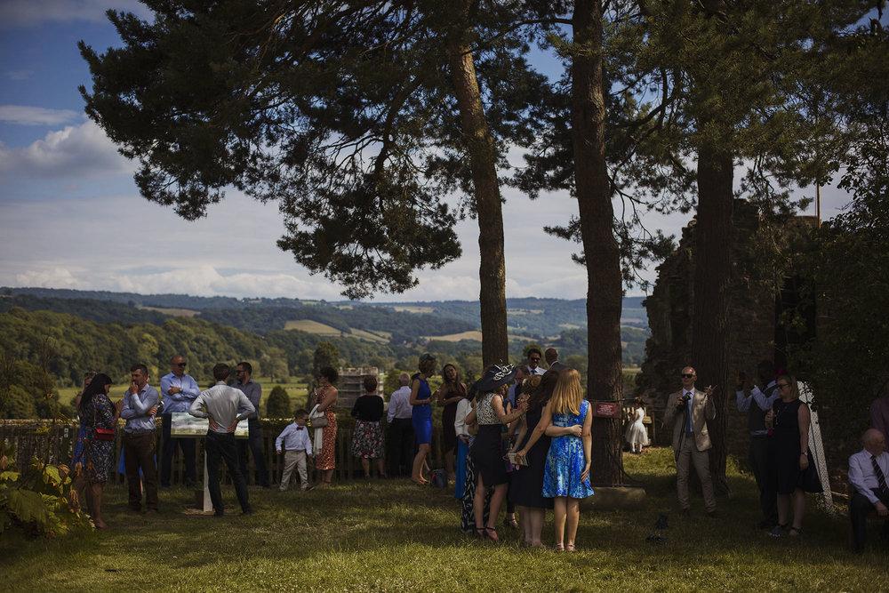 wedding guests mingling at usk castle