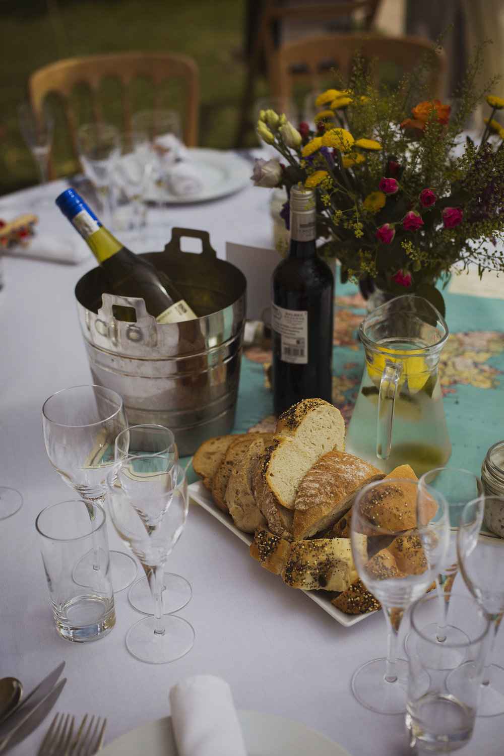 bread and wine on wedding breakfast table at usk castle