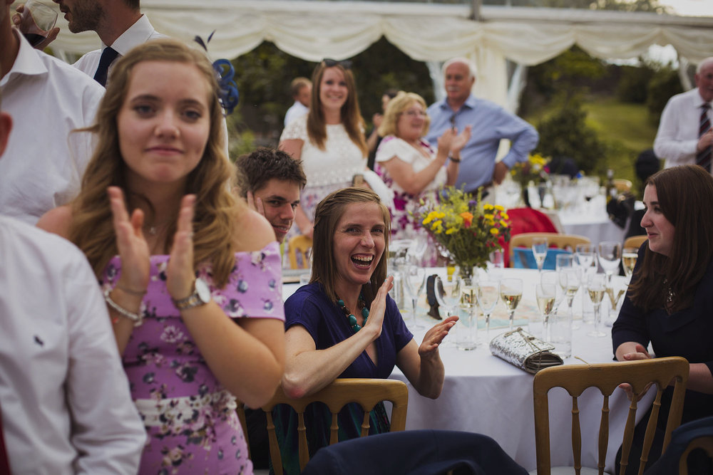 wedding guests applauding cake cutting at usk castle