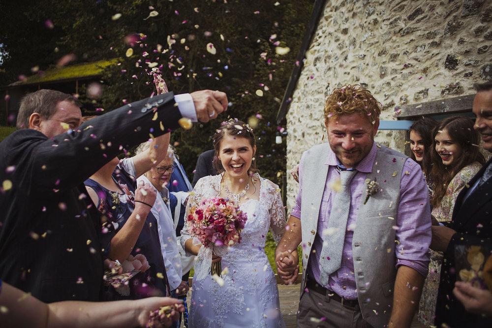 bride and groom confetti photo at nantwen