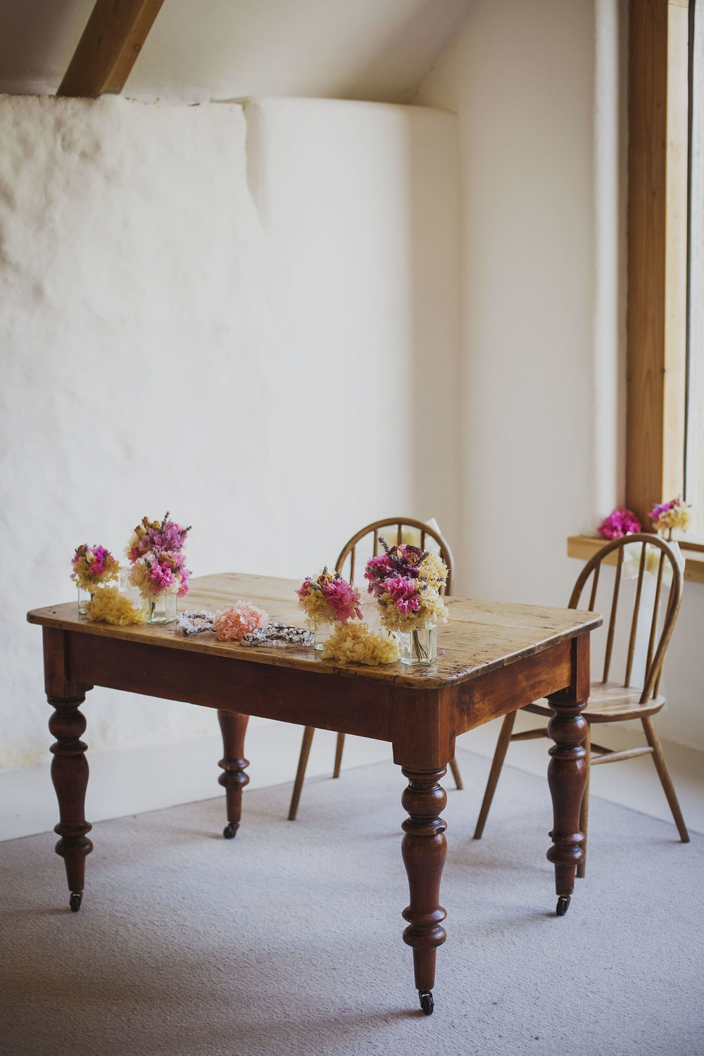 nantwen wedding venue table with flowers