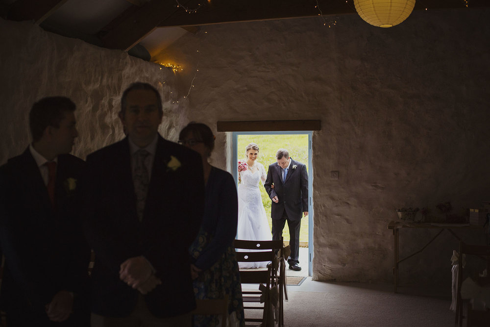 bride and father walking down isle at nantwen wedding venue