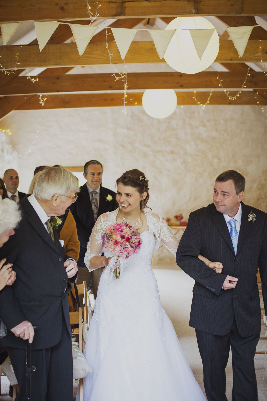 bride greeting groom's father at nantwen wedding venue