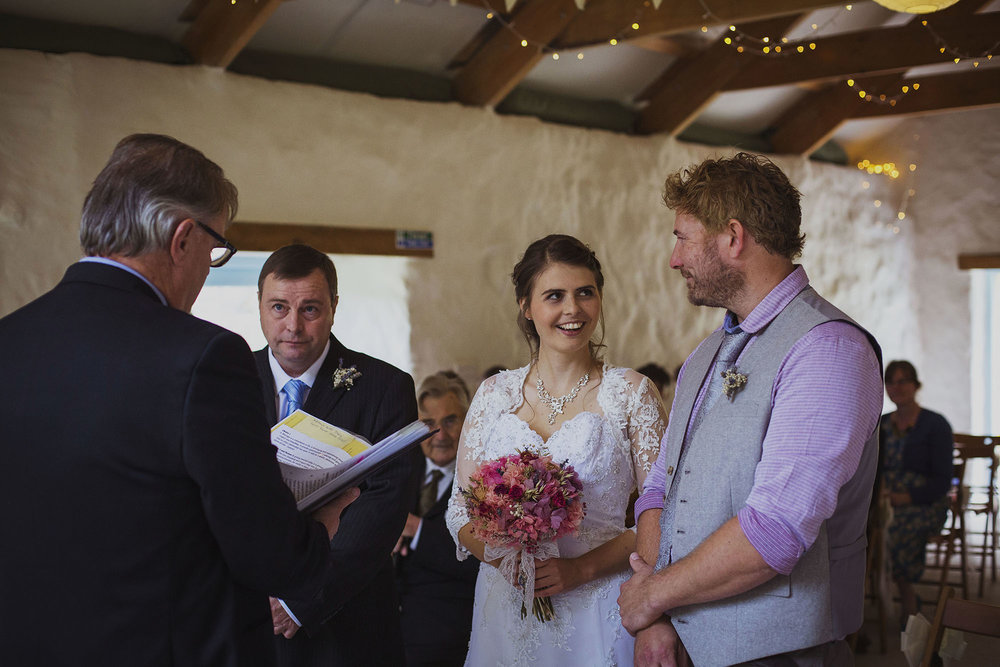 bride looking at groom during wedding ceremony at nantwen wedding venue