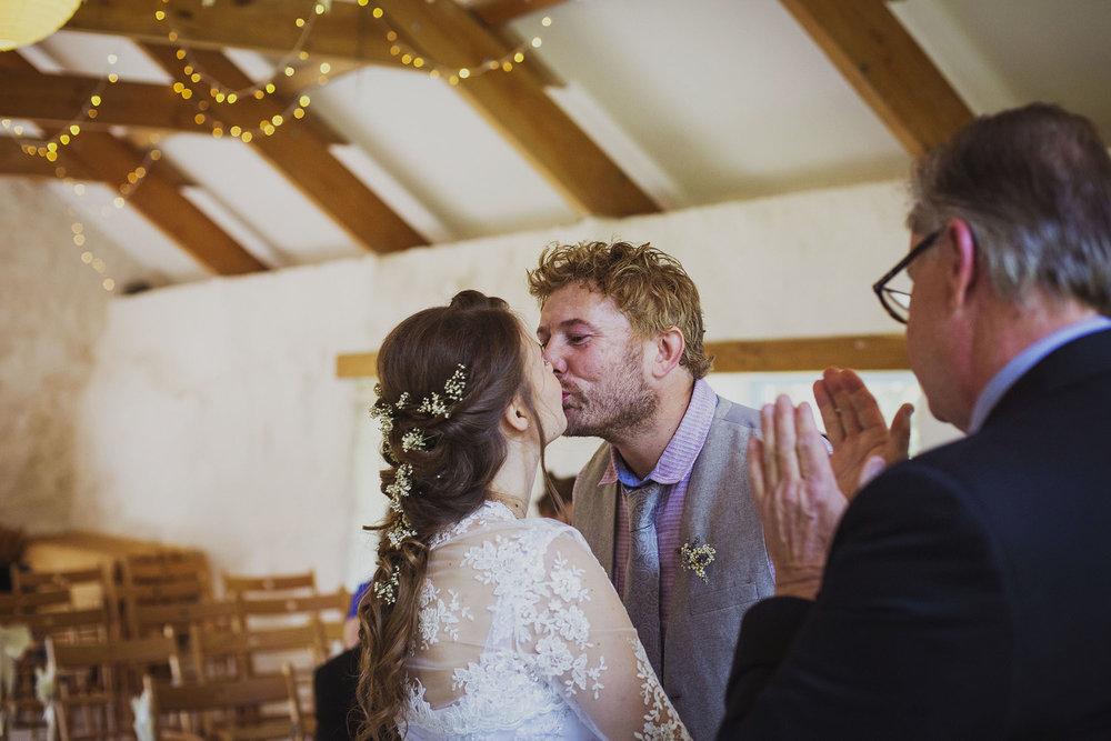 bride and groom first kiss at nantwen wedding venue