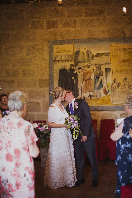 first kiss wedding ceremony at chateaux des ducs de joyeuses france destination wedding photography