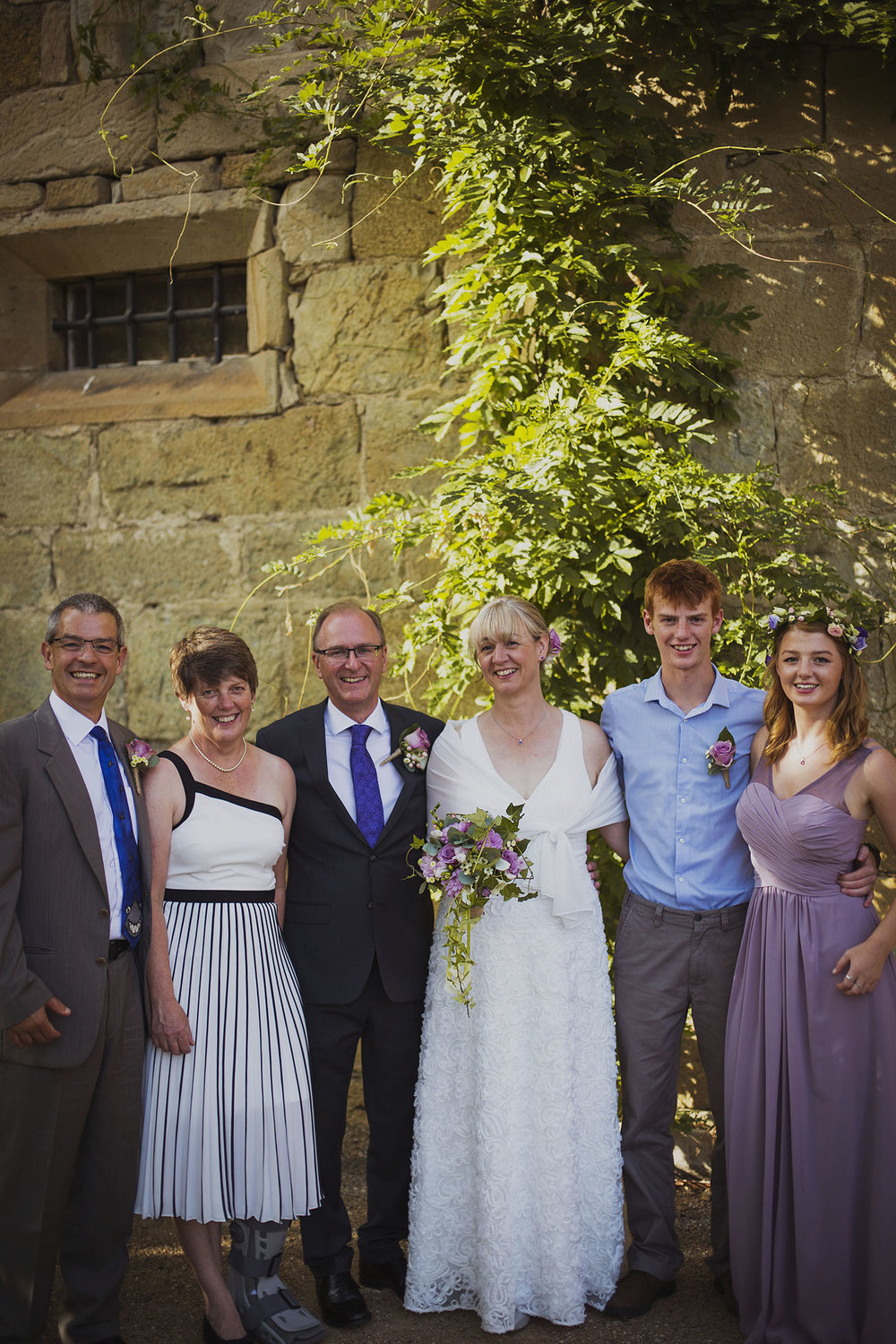 bride and groom with family at chateaux des ducs de joyeuses france destination wedding photography
