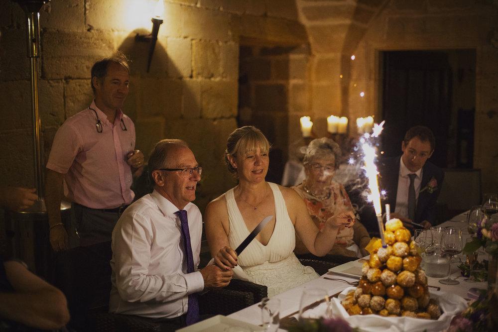 cake cutting at chateaux des ducs de joyeuses france destination wedding photography