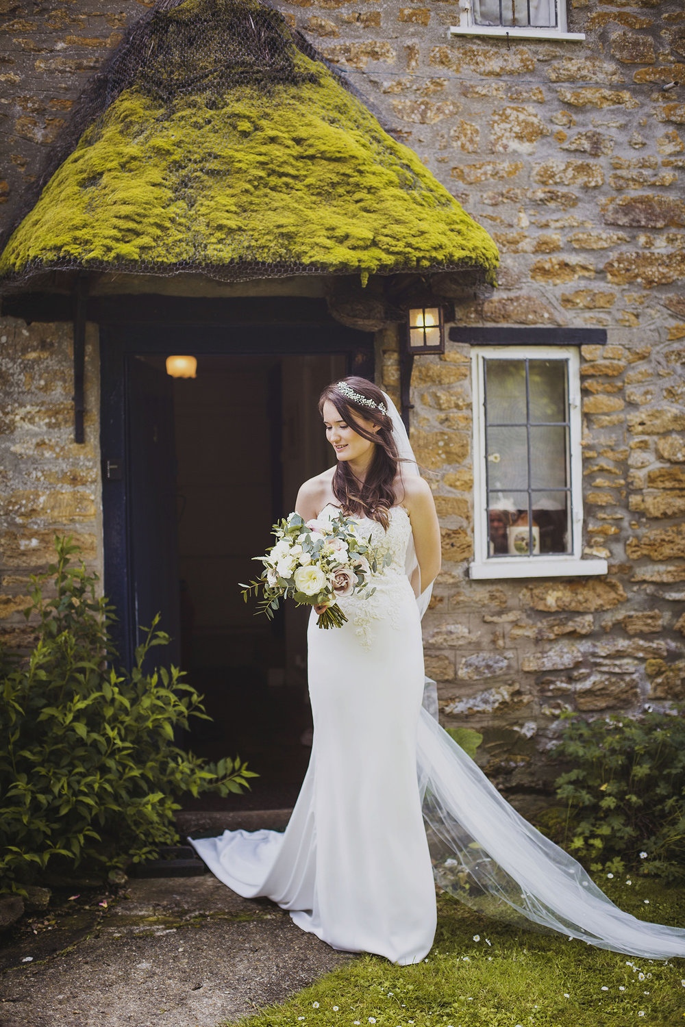 bride outside cottage ready for somerset wedding
