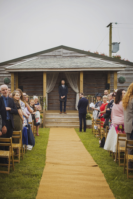 groom waiting at cott farm barn somerset wedding venue