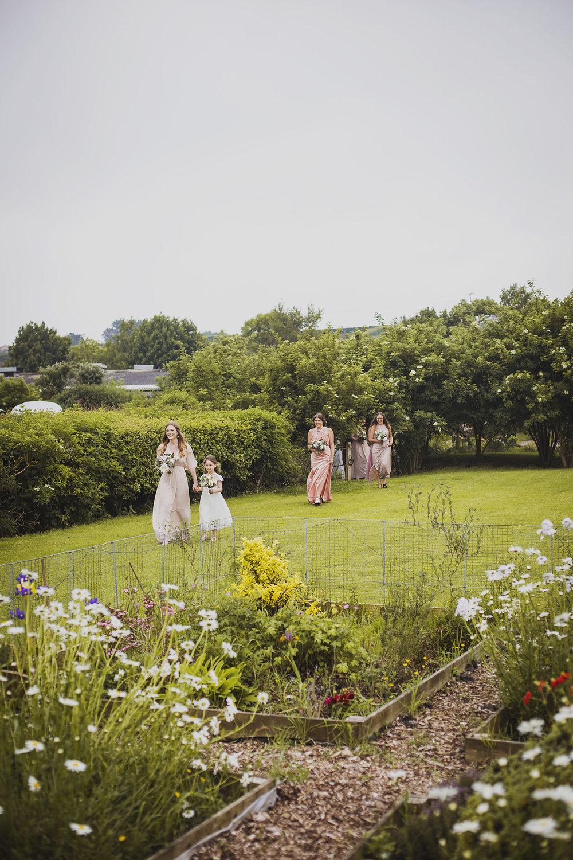 bridesmaids arriving at cott farm barn somerset wedding venue