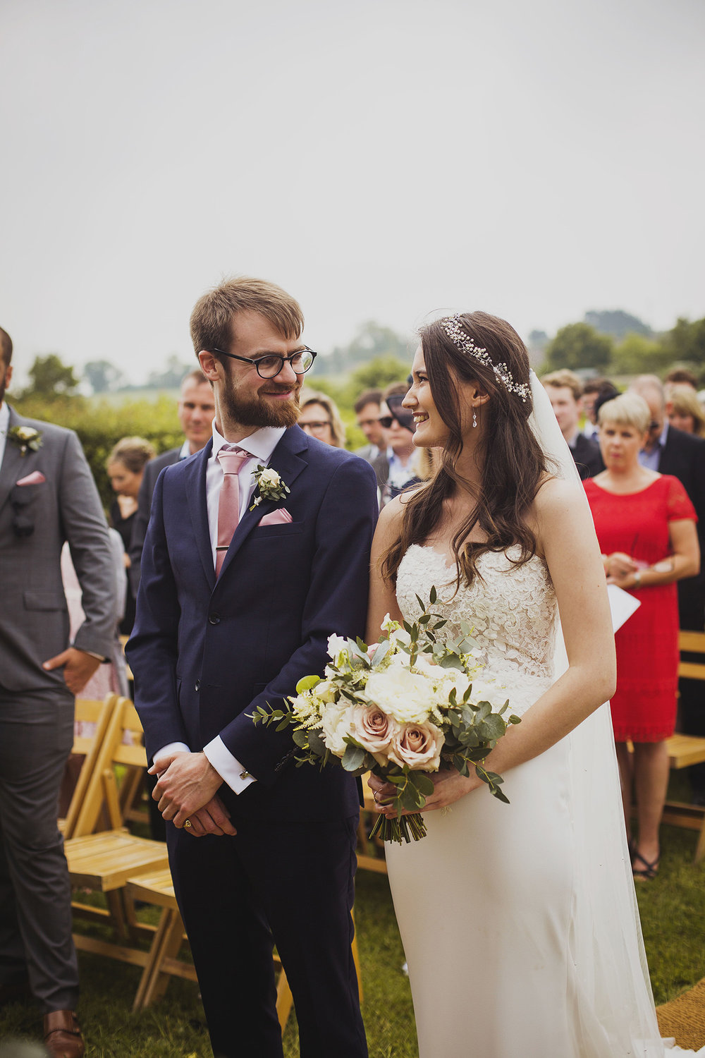 bride and groom first look at cott farm barn wedding venue somerset