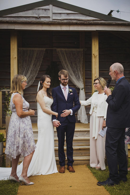 prayer at wedding ceremony at cott farm barn wedding venue somerset