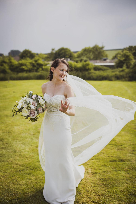 bride portrait at cott farm barn wedding venue somerset