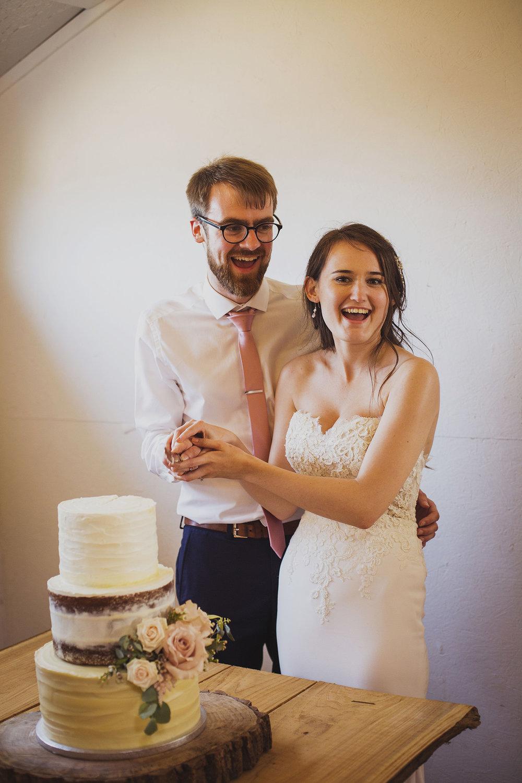 cake cutting at at cott farm barn wedding venue somerset