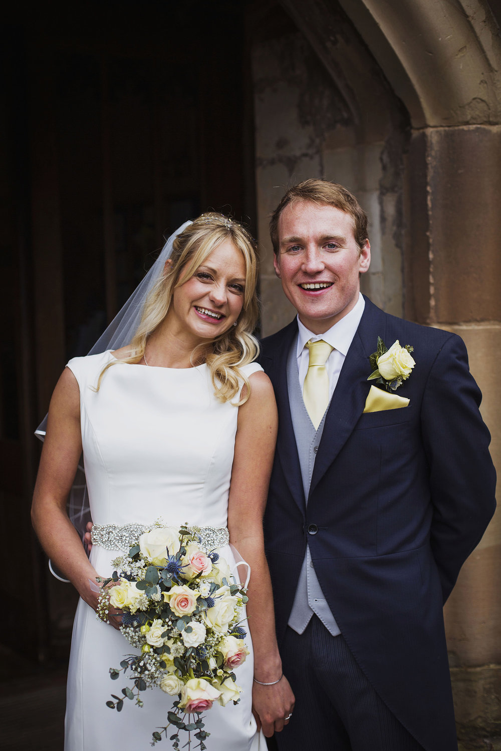 bride and groom just married at knowle parish church