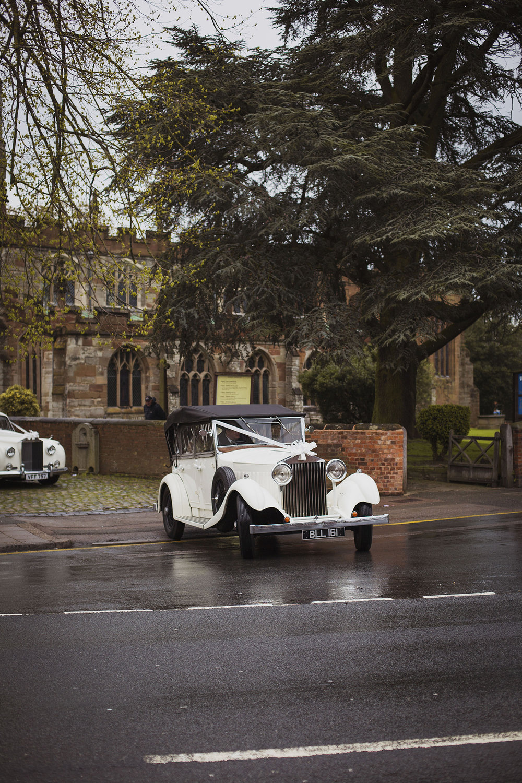 wedding cars leaving knowle parish church wedding
