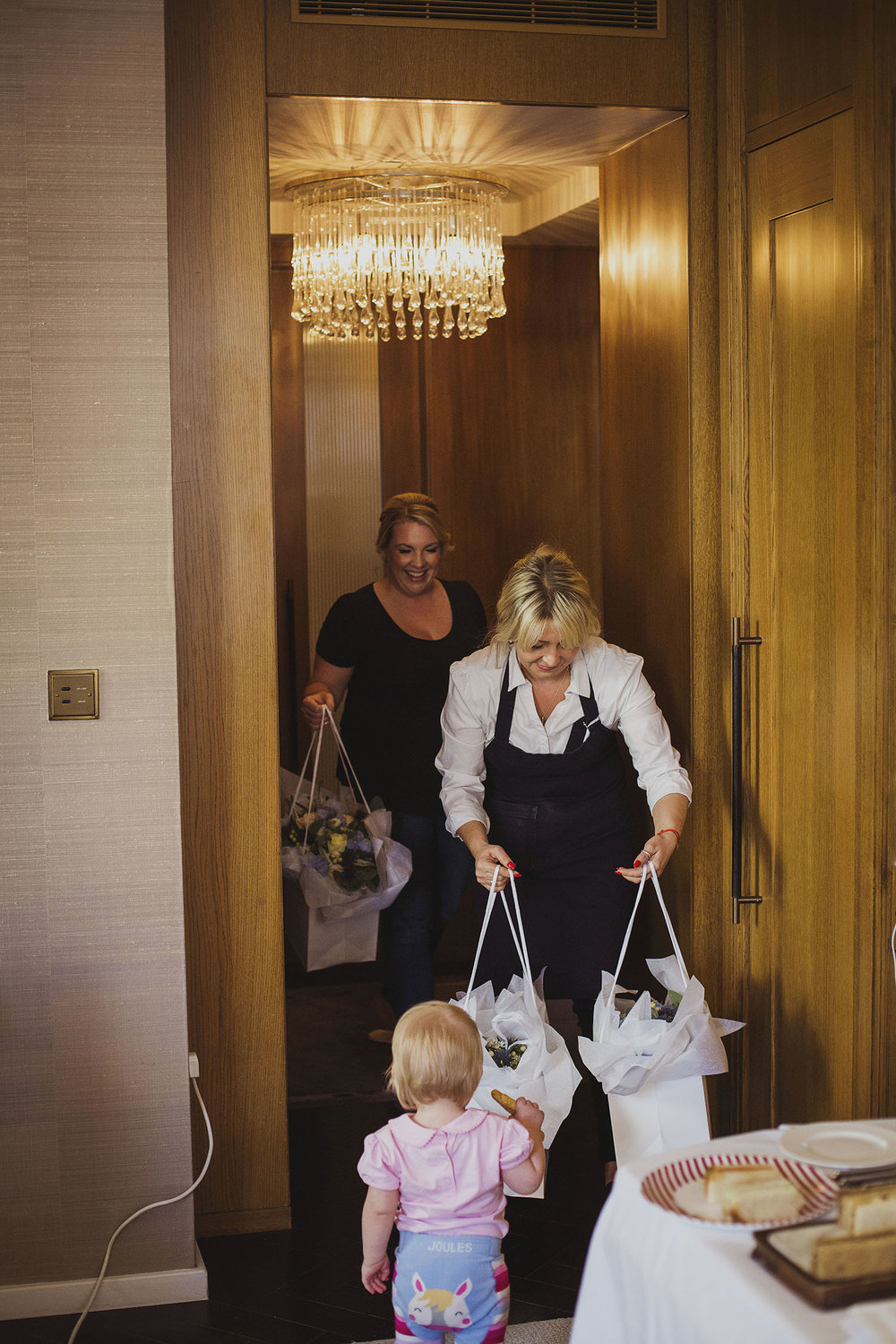 wedding flowers arriving corinthia hotel london wedding photographer
