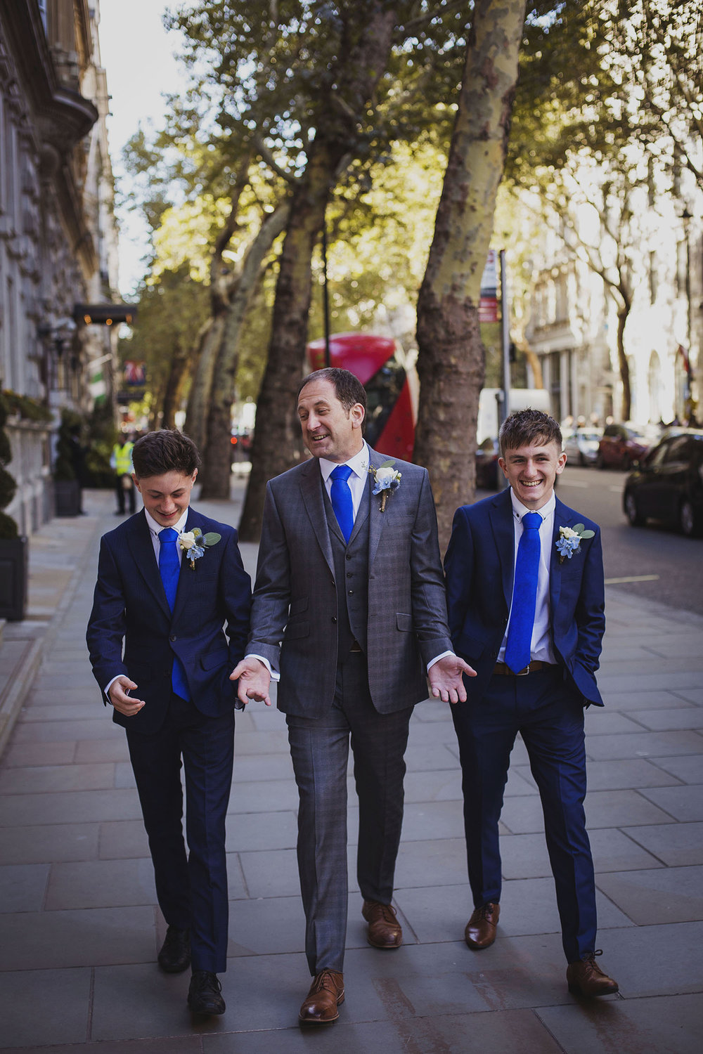 groom with groomsmen corinthia hotel london wedding photographer