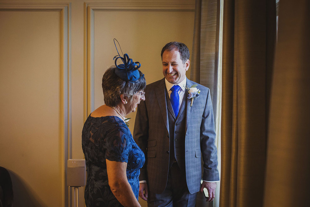 groom with mother pimlico room the old marylebone town hall wedding photographer
