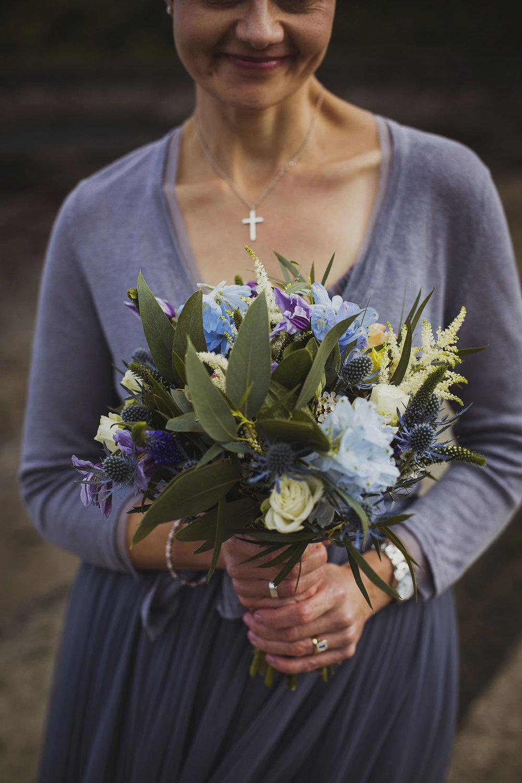 bride with flowers by annabel at beach nantwen wedding pembrokeshire wedding photographer
