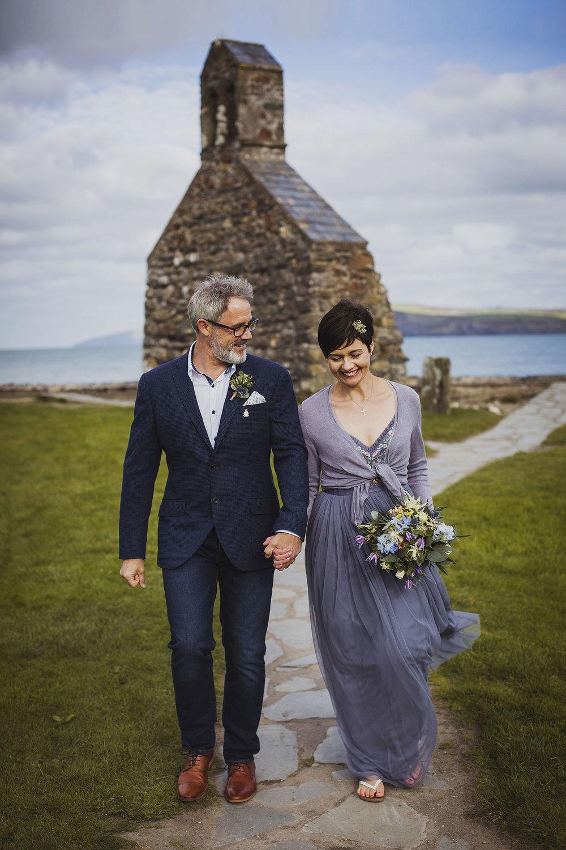 bride and groom at beach nantwen wedding pembrokeshire wedding photographer