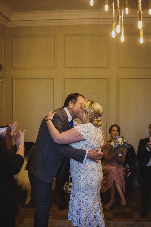 first kiss wedding ceremony pimlico room the old marylebone town hall wedding photographer