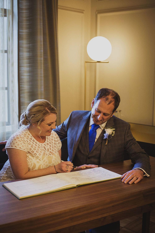 signing register wedding ceremony pimlico room the old marylebone town hall wedding photographer