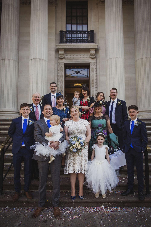 group wedding family photo on steps of the old marylebone town hall wedding photographer