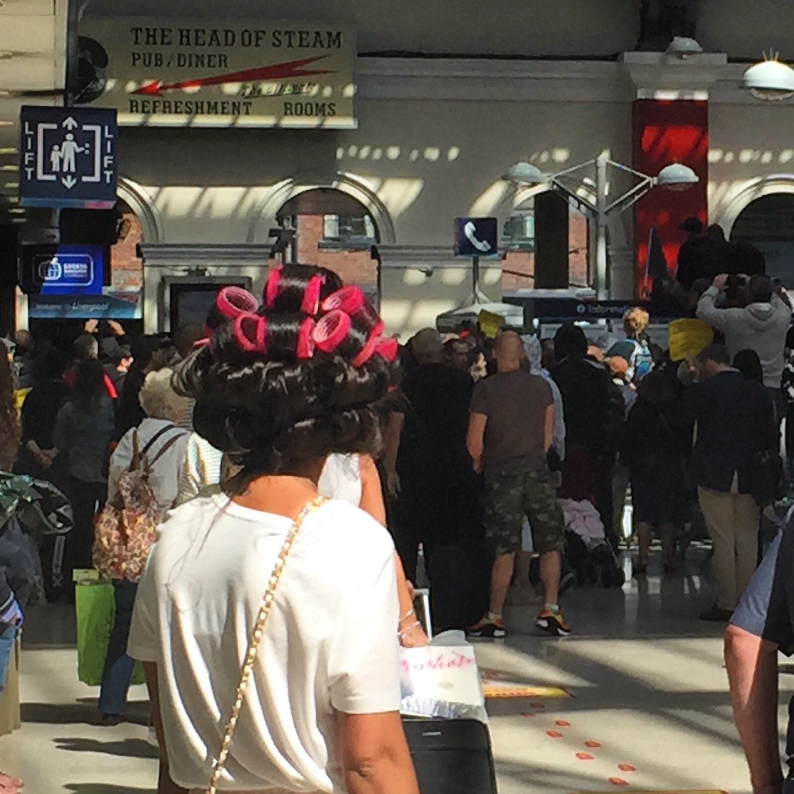 A girl with hair in rollers watches on as police battle to calm a clash between white supremacists and anti-fascism protesters at Liverpool Lime Street Station in August, 2015. Pic copyright @jabberingjourno